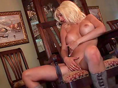 Blonde with fake tits Puma Swede shows off her puss