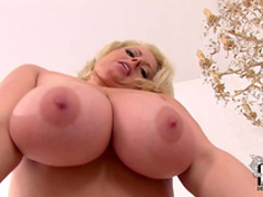 Blonde with big tits Lola is playing with her red bra