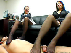 Nylon girls give him footjob