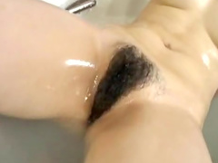 Horny all-natural Asian beauty is demonstrating her nice pussy