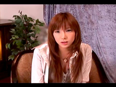 Redhead Japanese beauty being pokes by a dildo
