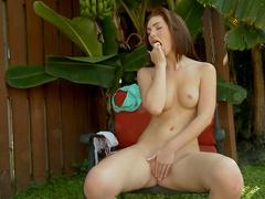 Slender brunette Natalie Lust is playing with a hose