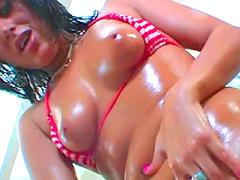 Busty brunette Dasani Lezian masturbates her oiled pussy