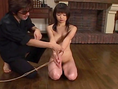 Slender brunette being tied and humiliated