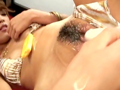 Hot babe is poking her hairy oiled pussy
