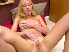 Blonde Eva Kay is poking her tasty pussy