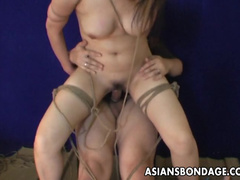 Cute Asian babe is riding on that rubber dick