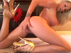Slender big-titted blonde takes off her luxury red dress