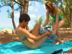 Beachside handjob from teen