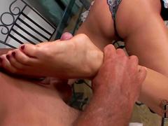Pretty blonde Daria Glower is masturbating dick using her legs
