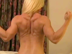 Muscular blonde nude in hotel