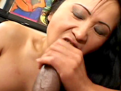 Dick-sucking Asian babe is getting black dick in her mouth