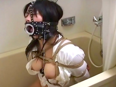 Sensual babe with gag in mouth is so submissive