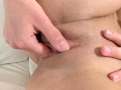Slender brunette Lorena is poking her shaved pussy