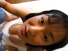 Tied Asian schoolgirl is getting cum on her face