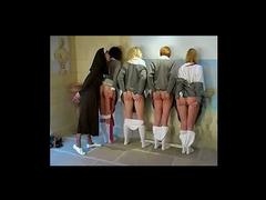 Nun spanks four schoolgirls