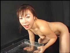 Nasty redhead Asian babe fucks in her skull