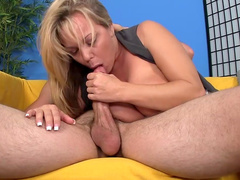 Big-tit chick gives a professional blowjob