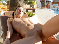 Ivana is lying at the poolside and touching her puss