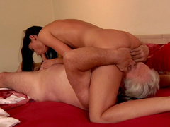 Tanned brunette has 69 sex with an old guy