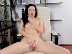 Arian is a brunette with small tits and long hair
