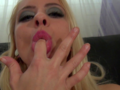 Pretty blonde Cameron Canada is sucking her finger