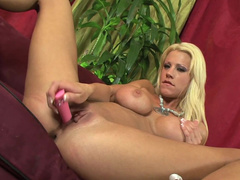 Tanya James is touching her shaved pussy