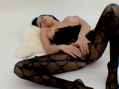 Brunette Molly is posing in her sexy bodystocking
