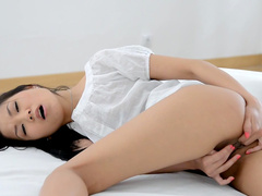 Sensual brunette with innocent face Sayuri is playing with her puss