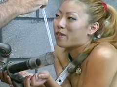Asian BDSM slut sucks cock