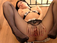 Molly stretches her puss in fishnet