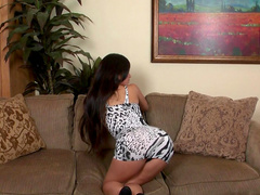 Miko Sinz sitting on a sofa and showing her tits