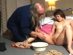 Asian girl explores bondage and submission