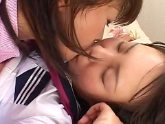 Alluring Japanese cuties are kissing each other pusses