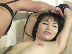 Kinky Asian lesbian in bondage video