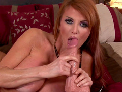 Redhead milf with fake tits inserts a dildo in her snatch
