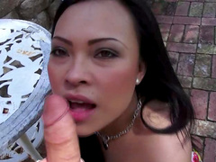 Young Asian sucks and fucks outdoors