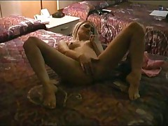 Blonde masturbates in motel room