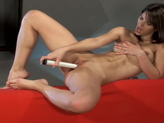 Demi L plays with her big long white dildo