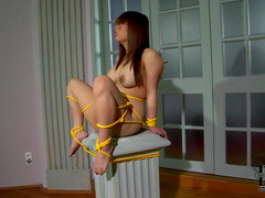 Fascinating and tied solo girl Tigerr Benson is pissing indoors