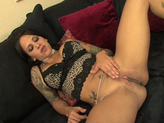 Tattooed brunette Regan Reese plays with dildos