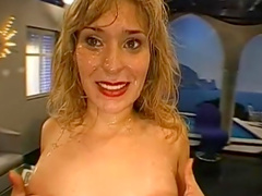 Glamorous blonde milf enjoying cum and taking part in bukkake