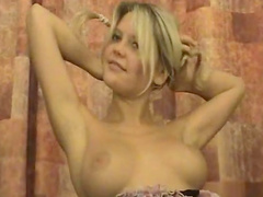 Blonde Amber is playing with her small tits