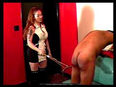 Slender redhead milf is spanking her slave