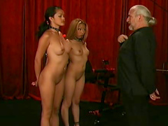 Old guy uses two young BDSM slaves