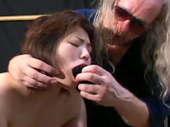 Hairy guy pours hot wax over body of that Asian