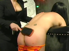 Asian model being spanked in hardcore style