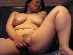 Chubby brunette is lying and fucking her pussy