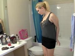 Blonde handjobs it rubbing her shaved pussy in the bathroom
