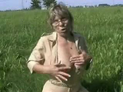 Milking mature with tied tits